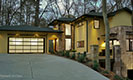 Avante Collection Garage Doors with Home at Sunset