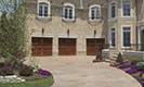 Reserve Wood Collection Limited Edition Series Garage Doors with Stone Home